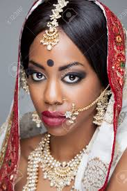 young indian woman dressed in traditional clothing with bridal makeup and jewelry stock photo 25661824