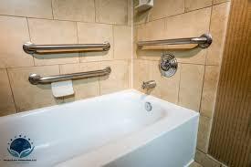 alt grab bar installation in hotel bathroom