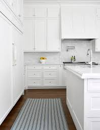 blue striped rug with all white kitchen
