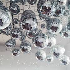 Decorative Disco Ball Ceiling covered in disco balls fun unique wedding decor idea 2