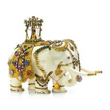 an antique multi gem ivory and gold elephant sculpture 19th century