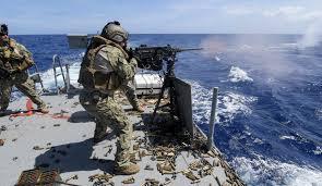 Us Navy Gunners Mate Fires A Machine Gun Aboard A Mark Vi Patrol