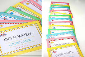 colorful envelopes with open when messages