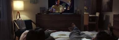 watching netflix on tv. photo of a person in bed watching netflix on tv. tv