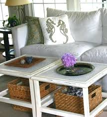 white coffee table with wicker baskets storage under coastal decorative ideas for a beach house