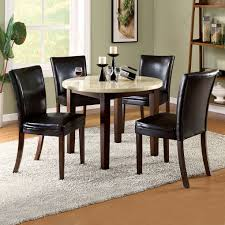classic black leather chairs white round table candle places wine bottle some glasses comfortable carpet