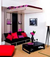 There is a bed on top and it moves up and down and a black couch