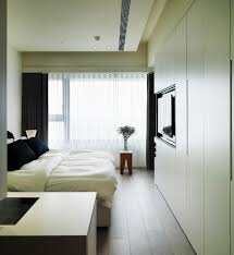 white themed bedroom small white themed apartment master bedroom idea with built in wall wardrobe bedding and cool tv on wardrobe