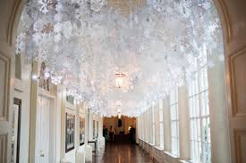 hand cut paper snowflakes line the ceiling of the east colonnade the white house is expecting over 60 000 visitors this holiday season