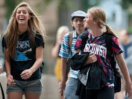 admissions university of wisconsin madison students laughing while walking across campus