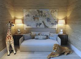 Safari themed boy's bedroom features planked walls lined with a safari  postcard art piece placed over