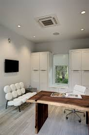 the new american home inspiration for a small contemporary study room remodel in calgary with black attractive modern office desk design