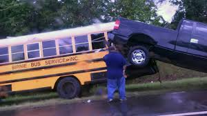 Pickup detaches from tow truck, hits school bus on I-295