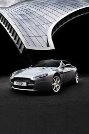 aston martin logo wallpaper. aston martin on dbs wallpaper 5 for the iphone and ipod touch logo