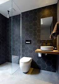 large scale black hexagon tiles with white grout make the walls more eye catching