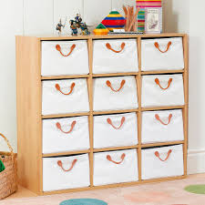 A storage unit made up of 12 canvas drawers and one modular storage unit
