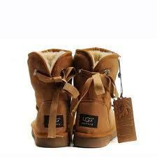 cute chestnut boots by UGG  ) love the bows. Find this Pin and more on UGG  Bailey Button Bomber 5838 Boots Jacket ...