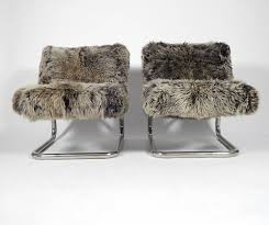a rather fabulous 1970s pair of lounge chairs with tubular chrome construction covered in a