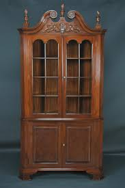brown wooden hutch carved cabinet with shelf and glass door alluring space saving