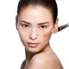 asian woman foundation application jpg