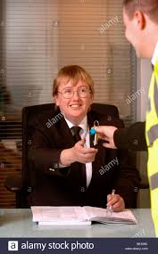 a security guard on patrol p keys to a front desk security officer at a business premises uk