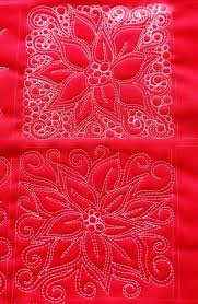 32 Free Quilting Designs for Machine Quilting | FaveQuilts.com & Poinsettia Free Motion Quilt Adamdwight.com
