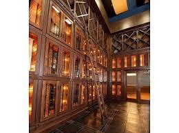 wine room lighting. Ladder In Large Wine Room For Restaurant Lighting
