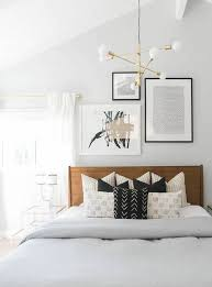 nice modern bedroom lighting. modern guest room decor with brass light fixture and wooden headboard nice bedroom lighting