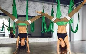 4 aerial yoga poses for a stronger