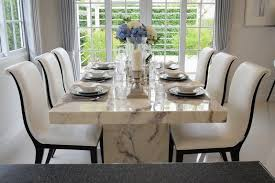 marble dining table and modern fortable chairs in a vine style with six place settings