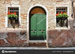 closed doors on a very old traditional brick home in venice italy stock photo