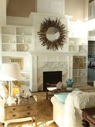 transitional living room photo in seattle with beige walls and a standard fireplace