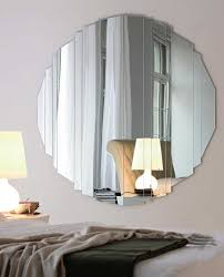 antique ultramodern round mirror and table lamp