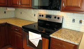 how to install glass backsplash cutting glass tile to cut glass tile around electrical s how how to install glass backsplash how to install tiles
