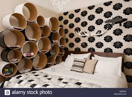 cardboard tube furniture. Cardboard Tube Storage Unit In Guestroom With Wallpaper Pattern From The Telma Collection At Manuel Canovas Furniture