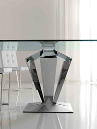 curving silver steel base combined with glass top and white chairs on the white floor fascinating dining table