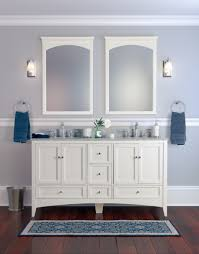 double vanity with two mirrors. two white wood framed bathroom mirror with wall sconces above double sinks vanity and mirrors v