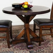 dining room round black wooden dining table with brown wooden legs plus brown wooden chairs