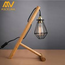 brief computer desk light cages wrought iron lamp cover log solid wood mount small table lamp
