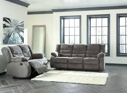 ashley recliner sofa reclining l furniture repair signature design by acieona with drop down table in