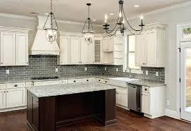 white kitchen grey backsplash kitchen white antiqued kitchen cabinets grey tiles marble under three chandeliers white