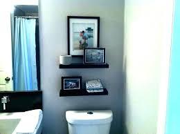 behind toilet shelf bathroom