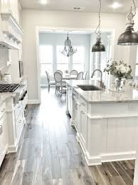white kitchen wood floor. Wonderful Kitchen Iu0027m Obsessed With This White Kitchen The Pendant Lights And Wood Tile Floor  Makes For A Really Gorgeous Room And White Kitchen Wood Floor