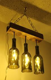 Make a Chandelier for Reusing Wine Glass Bottles -would look good over an  island in a kitchen