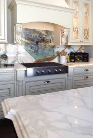 Beautiful kitchen with three different stone colors! Island: Calacatta Gold  Polished marble. Perimeter