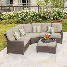 tacana 4 piece wicker patio sectional set with beige cushions