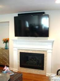 tv above fireplace ideas over the fireplace above fireplace ideas pictures modern tv above fireplace design