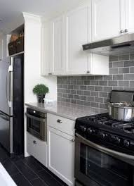 Delightful Light Gray Subway Tile Backsplash With Dark Grey Tile Floors And White  Cabinets. Love This. Maybe Add Some White Quartz Countertops