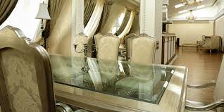 glass dining table in modern homes
