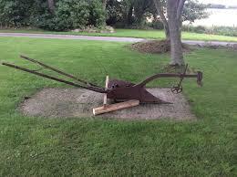 vine horse drawn furrow plough farm implement or garden ornament